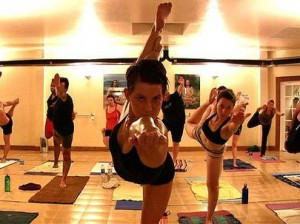 """On 4-feb-09, at 11:17 am, van der voort, jane wrote: image of bikram yoga beaches instructor dana moore, and class. Frame-grab from rene johnston's video. For living section """"it"""" page, jane vdv"""
